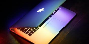 MacBook with rainbow effect.