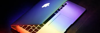 MacBook with rainbow effect.