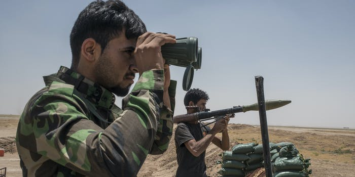 NINEVEH, IRAQ - JUNE 20: An Iraqi PMF fighter looks through binoculars June 20, 2017 on the Iraq-Syria border in Nineveh, Iraq. The Popular Mobilisation Front (PMF) forces, composed of majority Shi'ite militia, part of the Iraqi forces, have pushed Islamic State militants from the north-western Iraq border strip back into Syria. The PMF now hold the border, crucial to the fall of Islamic State in Mosul, blocking the Islamic State supply route for militants from Syria to Mosul. (Martyn Aim/Getty Images).