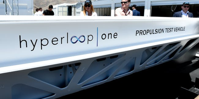 NORTH LAS VEGAS, NV - MAY 11:  People look at a demostration test sled after the first test of the propulsion system at the Hyperloop One Test and Safety site on May 11, 2016 in North Las Vegas, Nevada. The company plans to create a fully operational hyperloop system by 2020.  (Photo by David Becker/Getty Images,)