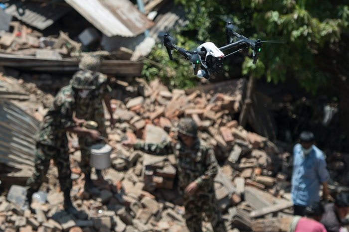 a-drone-flies-over-collapsed-buildings-d