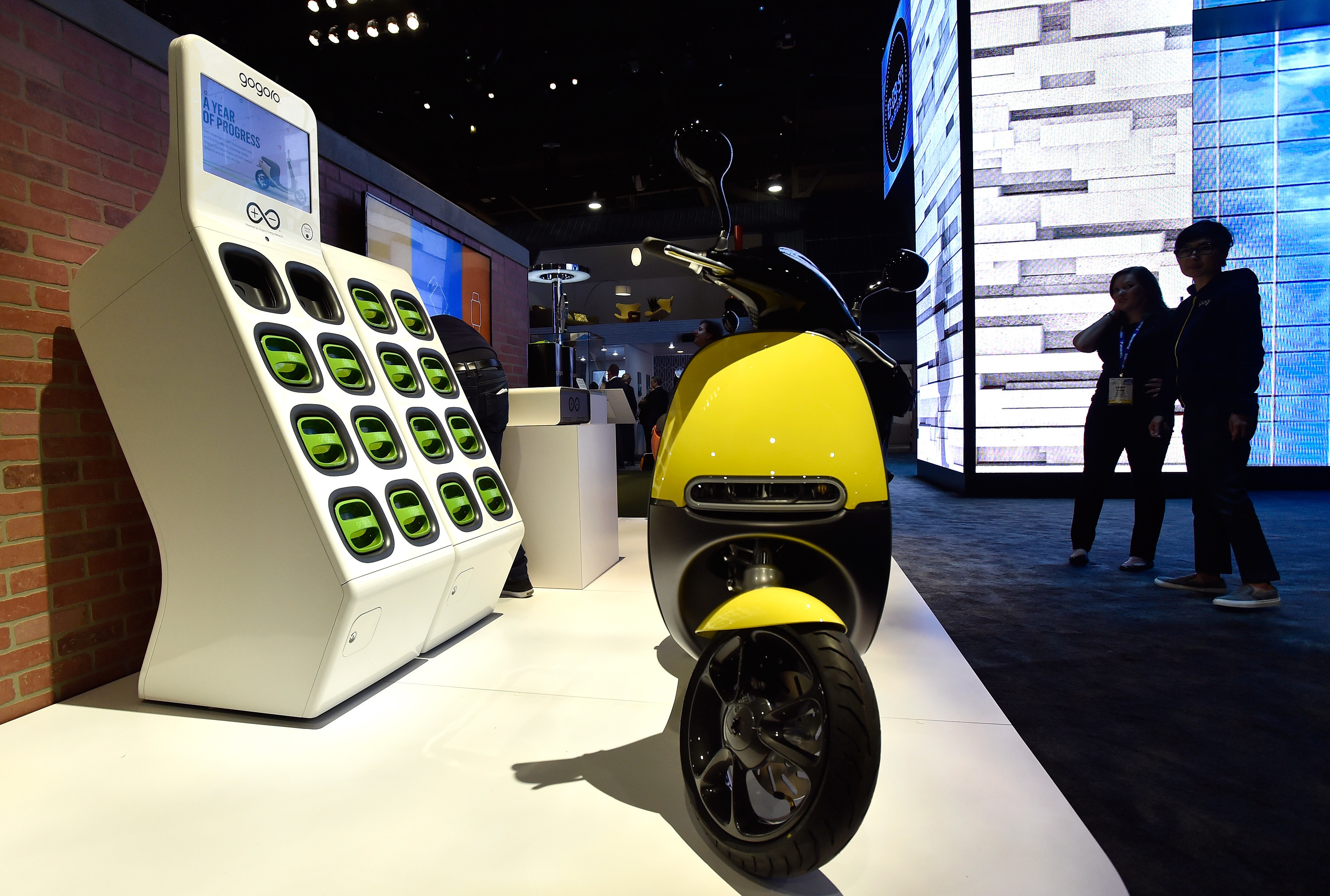 The Gogoro Smartscooter is displayed at the Panasonic booth at CES 2016 at the Las Vegas Convention Center on January 6, 2016 in Las Vegas, Nevada. The all electric scooter operates on portable shared batteries, which users switch out at various locations throughout a community.