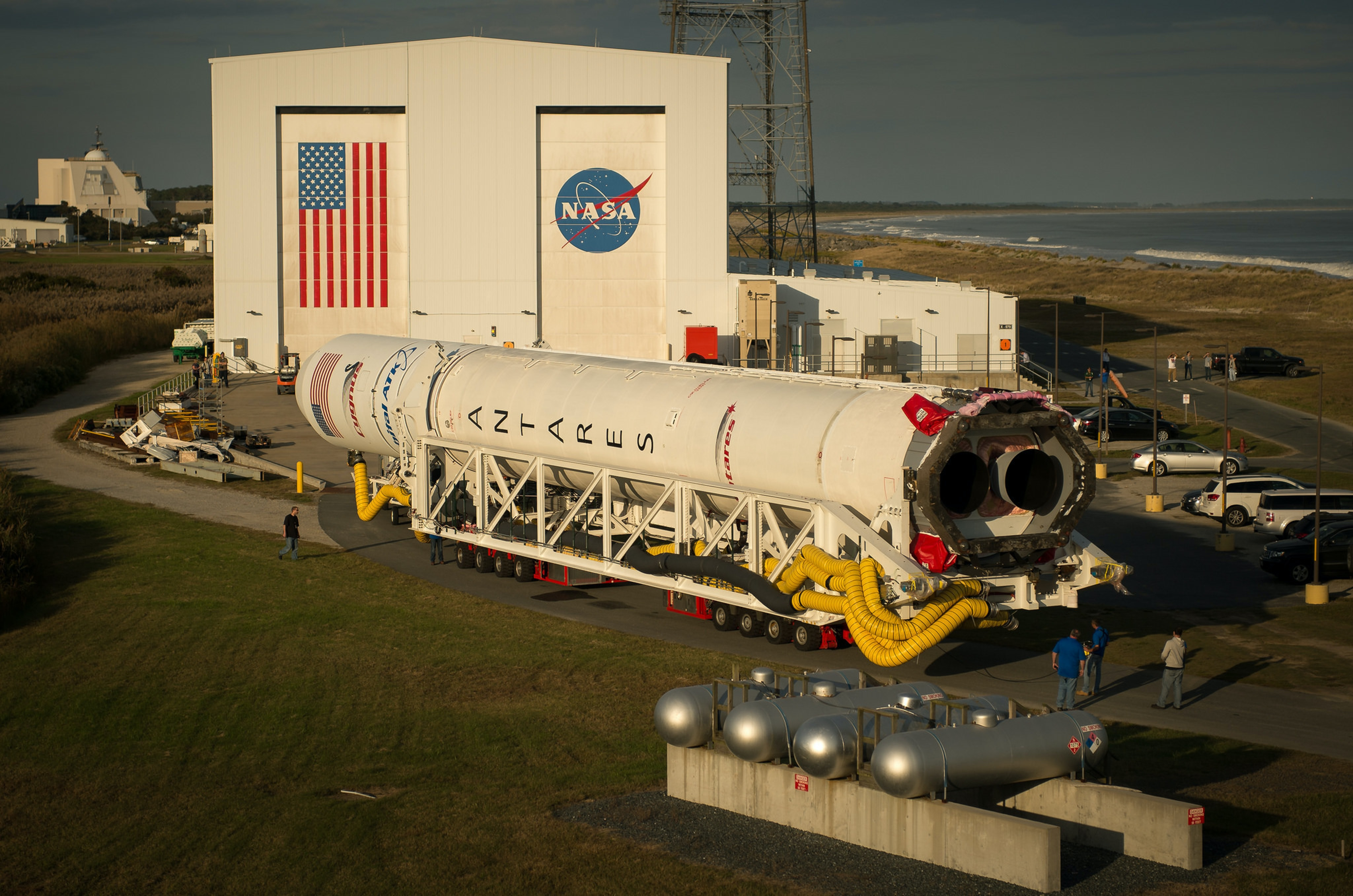 The Orbital ATK Antares rocket is rolled out of the integration facility and to the launch pad on October 13, 2016.
