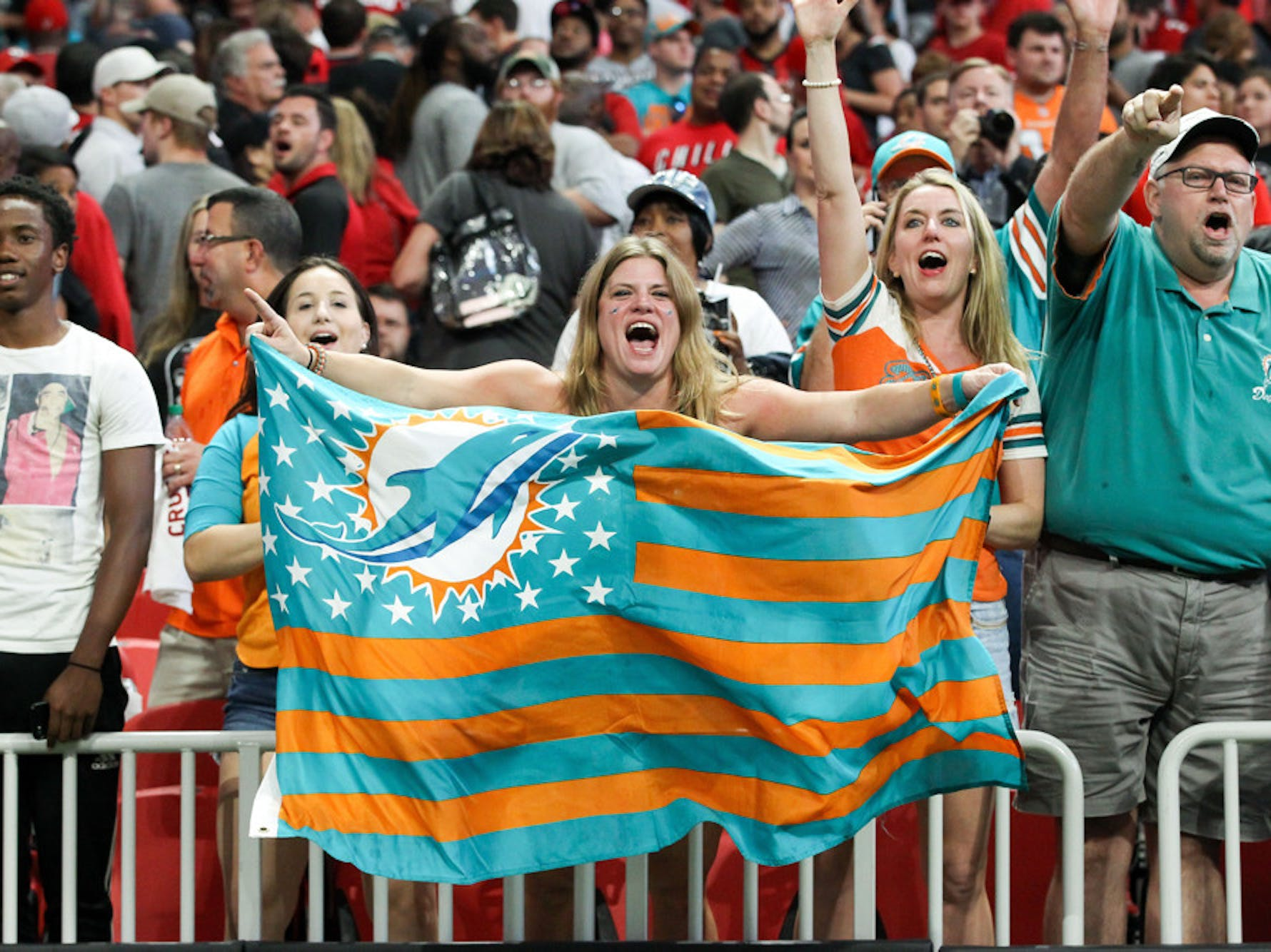 Miami Dolphins fans celebrate after the NFL game between the Miami Dolphins and the Atlanta Falcons on October 15, 2017 at the Mercedes-Benz Stadium in Atlanta, GA. Miami wins 20-17.