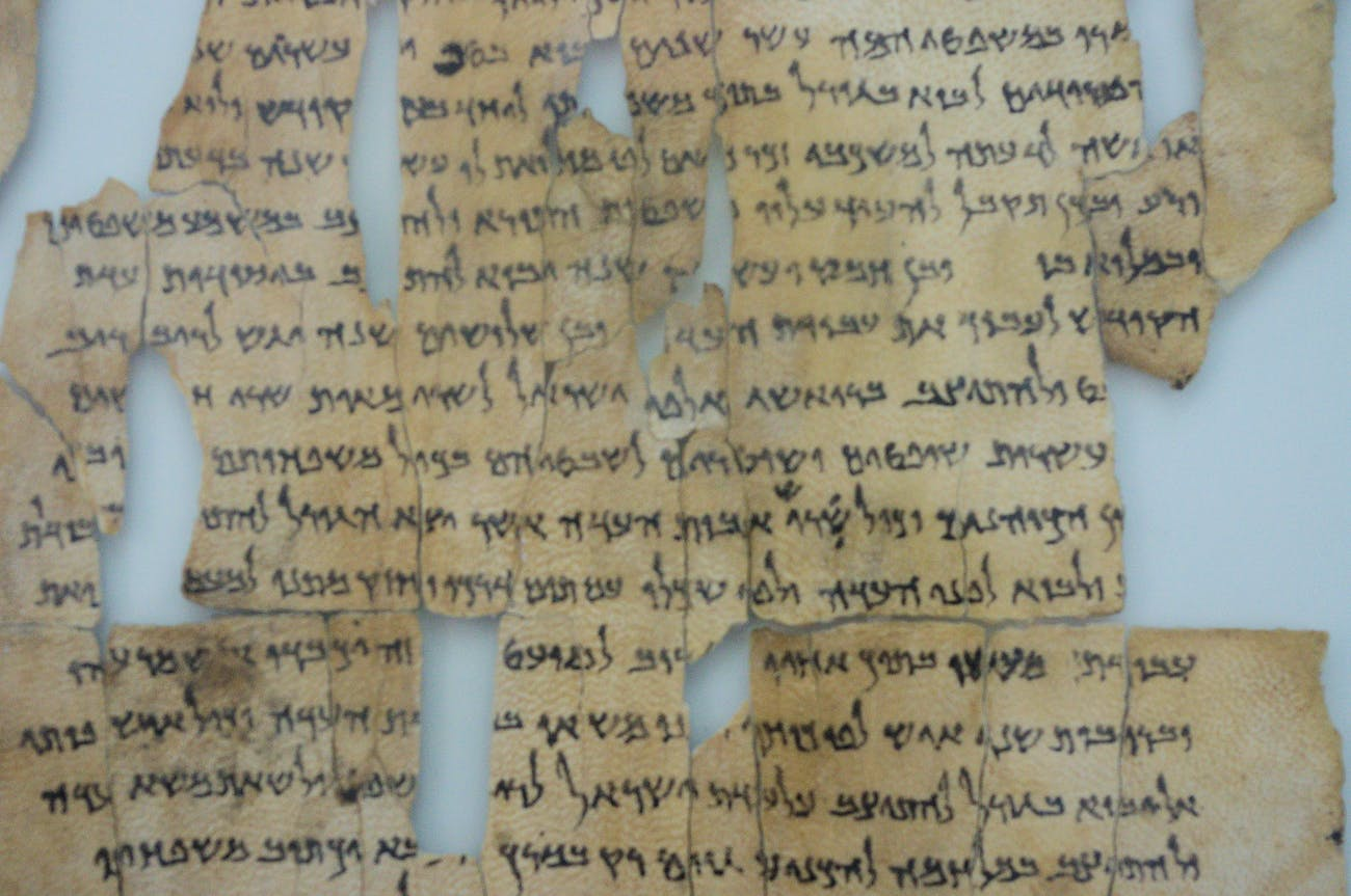 """The so-called """"Dead Sea Scrolls"""" are a set of ancient Jewish/Biblical documents discovered on the northwest shore of the Dead Sea between 1946 and 1956. Most are in Israel today, but this (and others) are in Jordan since borders have shifted over the years. Written in Hebrew, Aramaic and Greek, mostly on parchment, but with some written on papyrus and even copper, these manuscripts generally date between 150 BC and 70 AD. Many scholars believe therw were buried just before the Romans put down the """"Jewish rebellion"""" that ran from about 67 to 73 AD. The scrolls are traditionally identified with the ancient Jewish sect called the Essenes, but scholars debate that. In fact, many of the scrolls were declared """"state secrets"""" when they were found. It is sort of strange to think that something written over 2,000 years ago could still represent a national security risk today."""
