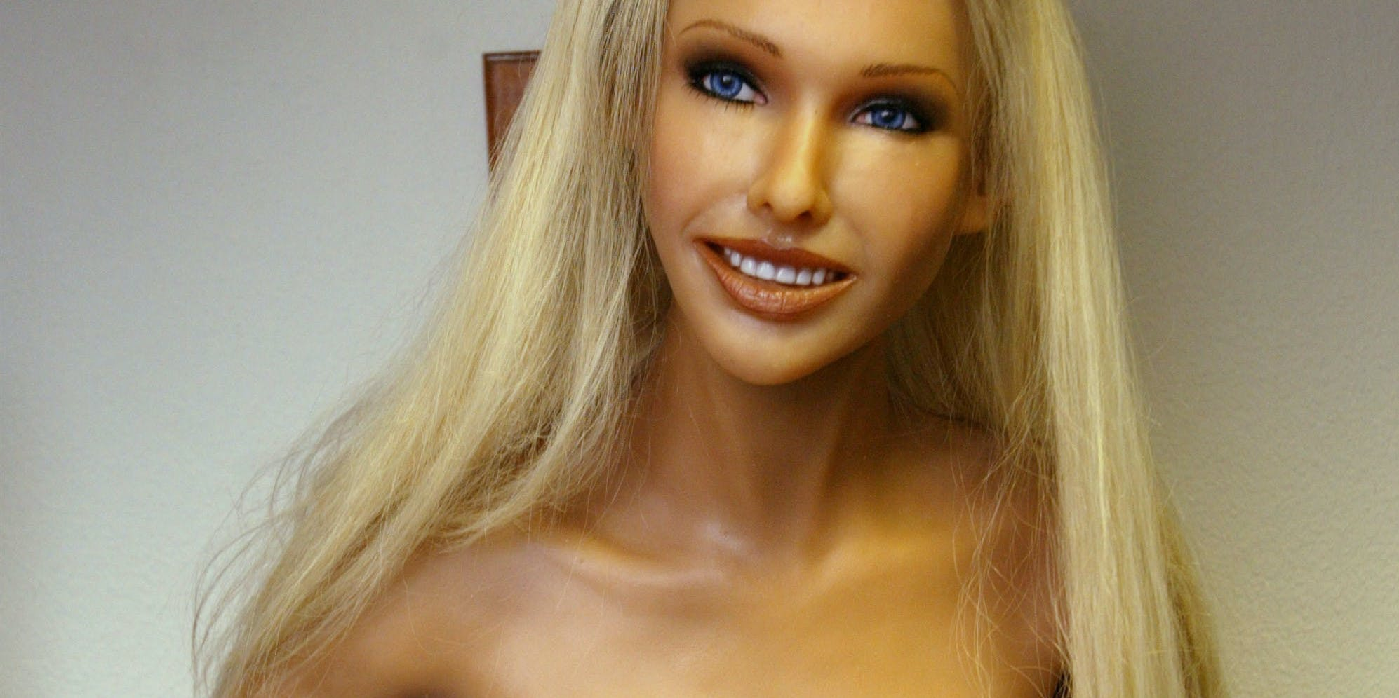 A finished silicone RealDoll sex doll stands topless at the Abyss Creations factory on February 5, 2004 in San Marcos, California. RealDolls are created using Hollywood special effects technology and have orifices made of a special soft grade of silicone for people who want to 'enhance their sex lives', according to Abyss Creations literature. Standard female models sell for about $6000, males for $7000, and are sold only over the Internet. 'Shemales' and other special orders are also available.