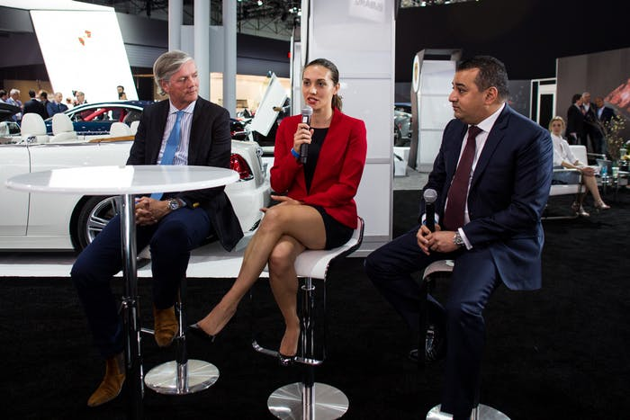 Monika Mikac, center, speaks at the Supercars Forum at the New York Auto Show.