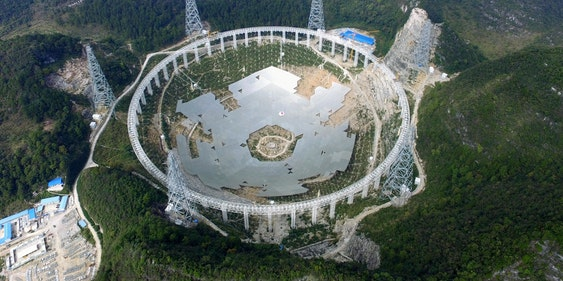 PINGTANG, CHINA - NOVEMBER 26:  (CHINA OUT) The feed supporting system of the five-hundred-metre Aperture Spherical Radio Telescope (FAST) is under test on November 26, 2015 in Pingtang County, China. The construction will be completed in September 2016.  (Photo by VCG/VCG via Getty Images)
