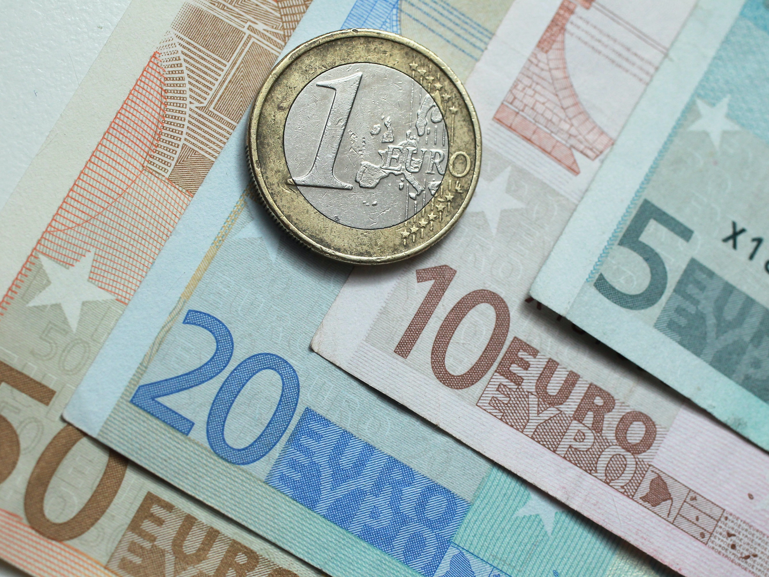 In this photo illustration a one Euro coin lies on Euro currency bills on June 21, 2011 in Berlin, Germany. Eurozone finance ministers are currently seeking to find a solution to Greece's pressing debt problems, including the prospect of the country's inability to meet its financial obligations unless it gets a fresh, multi-billion Euro loan by July 1. Greece's increasing tilt towards bankruptcy is rattling worldwide financial markets, and leading economists warn that bankruptcy would endanger the stability of the Euro and have dire global consequences.