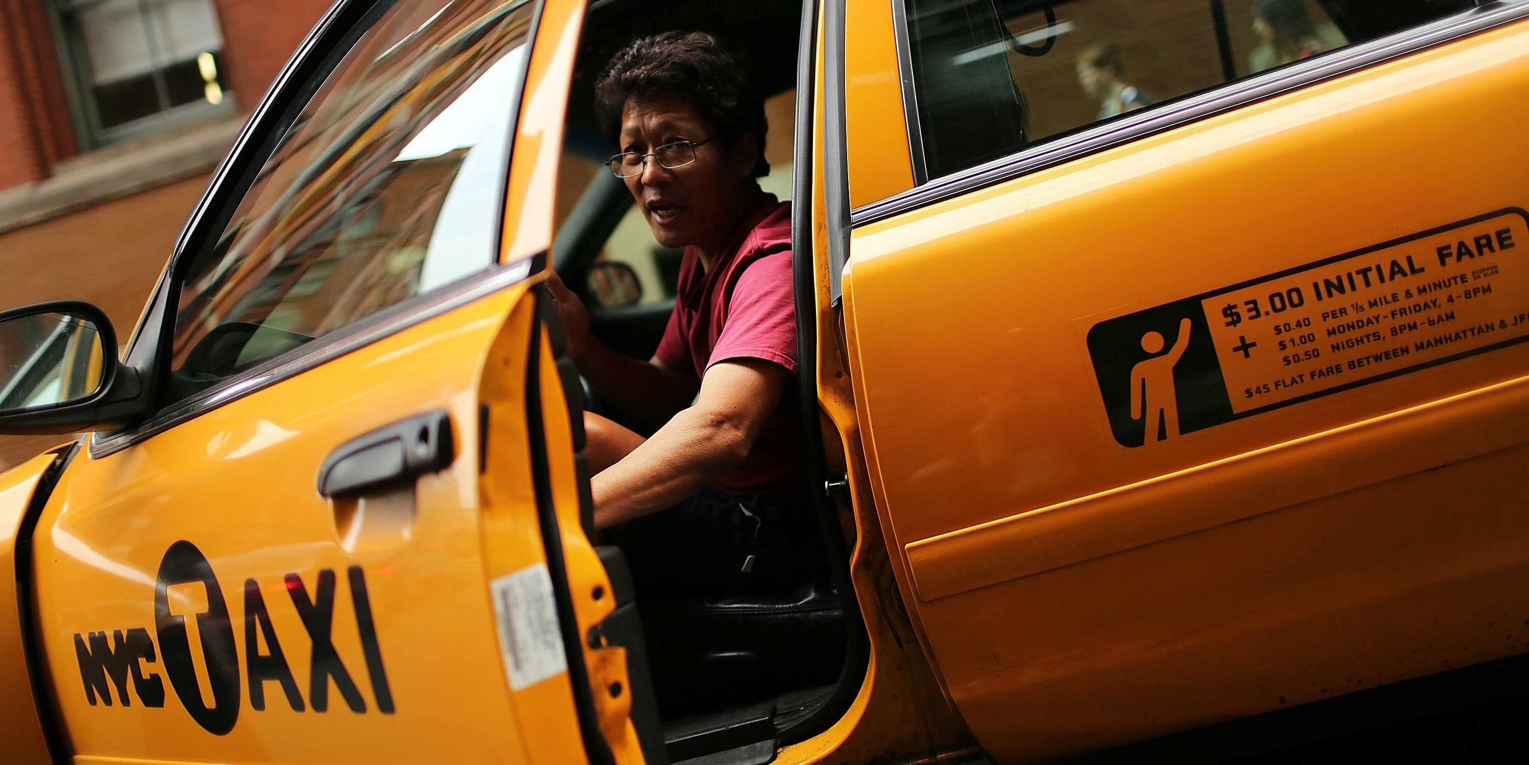 NEW YORK, NY - SEPTEMBER 04: A taxi driver pauses in his vehicle on September 4, 2012 in New York City. As of Tuesday, yellow taxis may begin charging more following an approved fare increase for riders. Taxi rates have remained virtually unchanged since 2006 and will now rise by an expected 17 percent. (Photo by Spencer Platt/Getty Images)