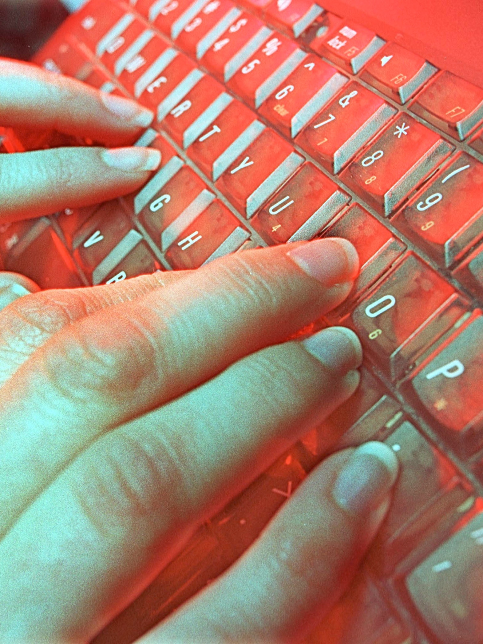 A photo illustration depicts a person typing May 4, 2001 in Denver, CO. National Academy of Sciences estimates that musculoskeletal disorders such as carpal-tunnel syndrome, tendinitis, and lower back pain cost the nation $45 billion to $54 billion in compensation, lost wages, and lower productivity each year.