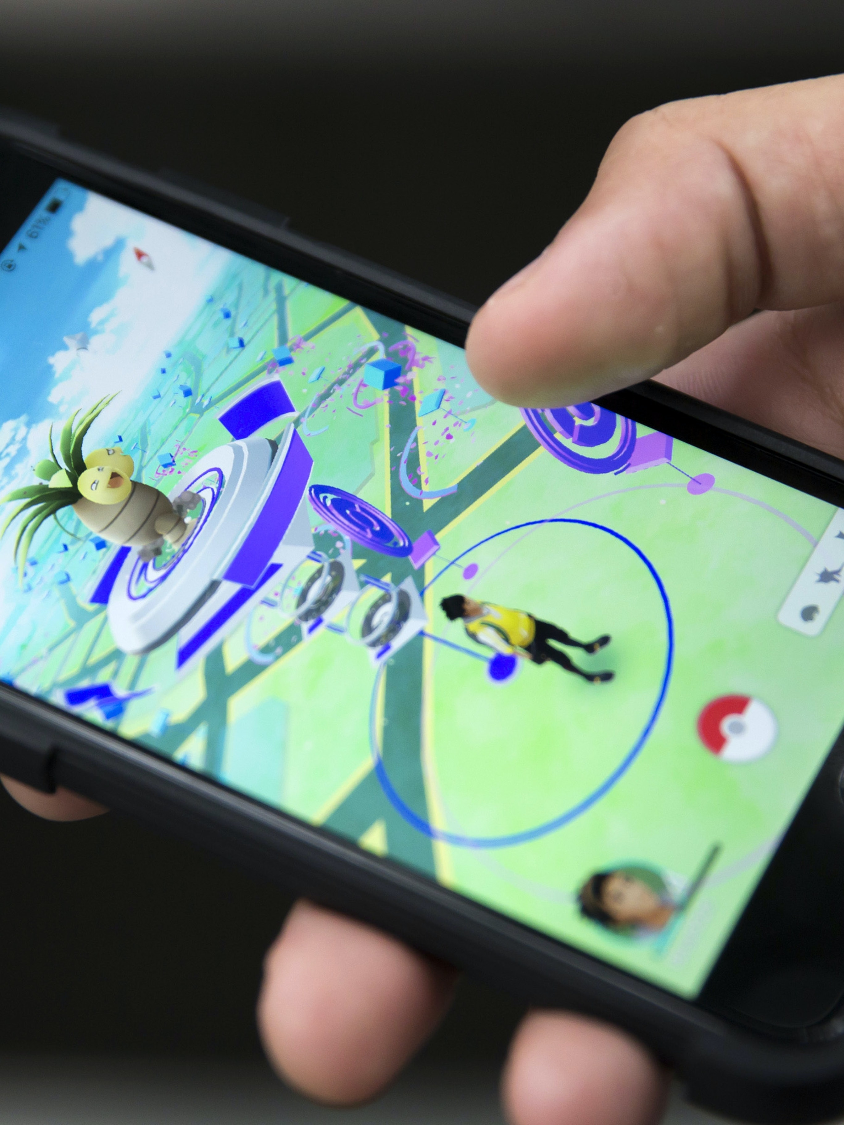 TOKYO, JAPAN - JULY 22:  A man plays Pokemon Go game on a smartphone on July 22, 2016 in Tokyo, Japan. The Japanese version of the game app Pokemon Go was released on July 22, 2016. Japan McDonalds' 3,000 restaurants in Japan will be turned into Pokemon gyms in collaboration with the fast-food chain.  (Photo by Tomohiro Ohsumi/Getty Images)