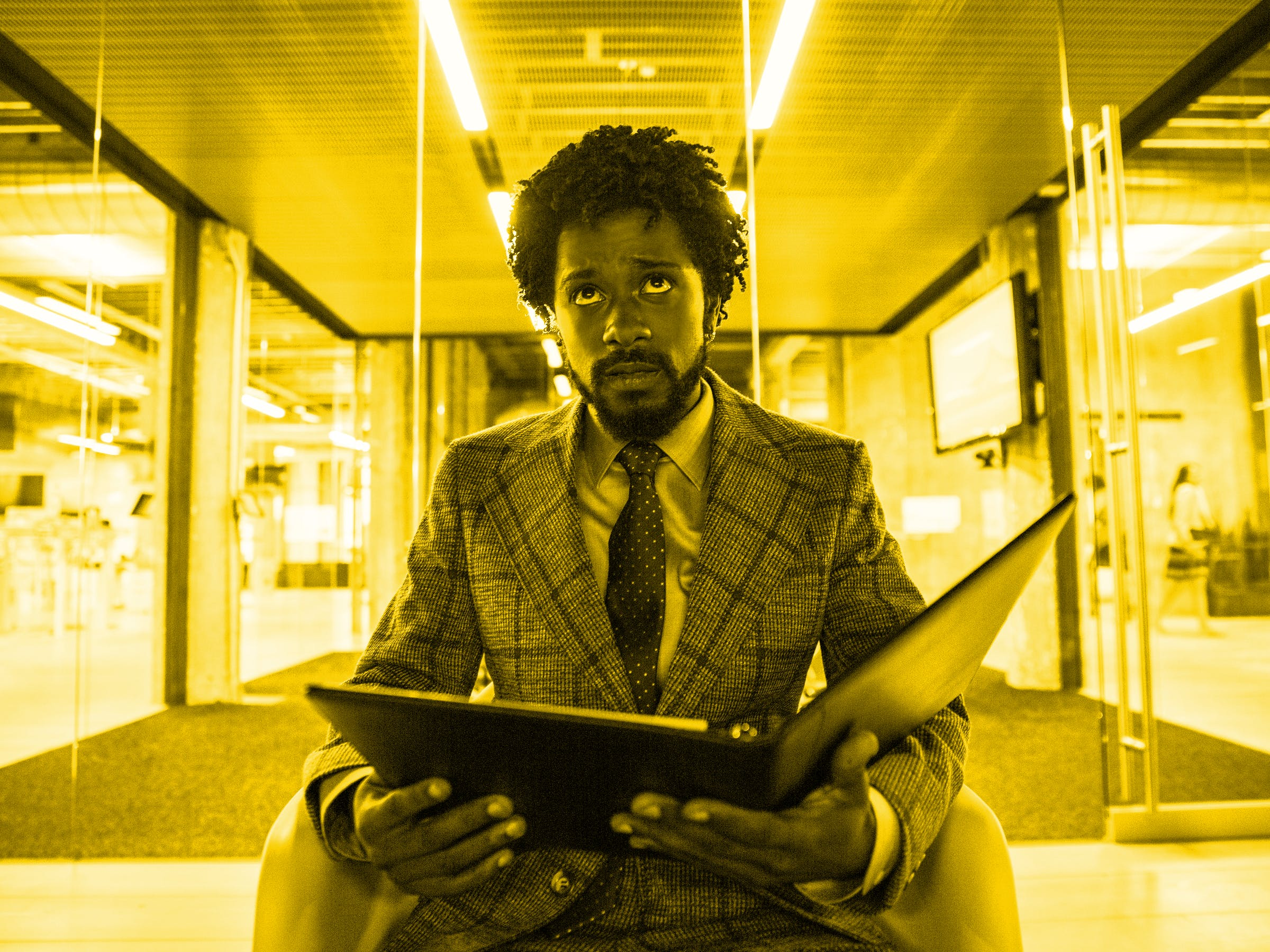 "Lakeith Stanfield as Cassius ""Cash"" Green becomes a ""power caller"" in 'Sorry to Bother You'."
