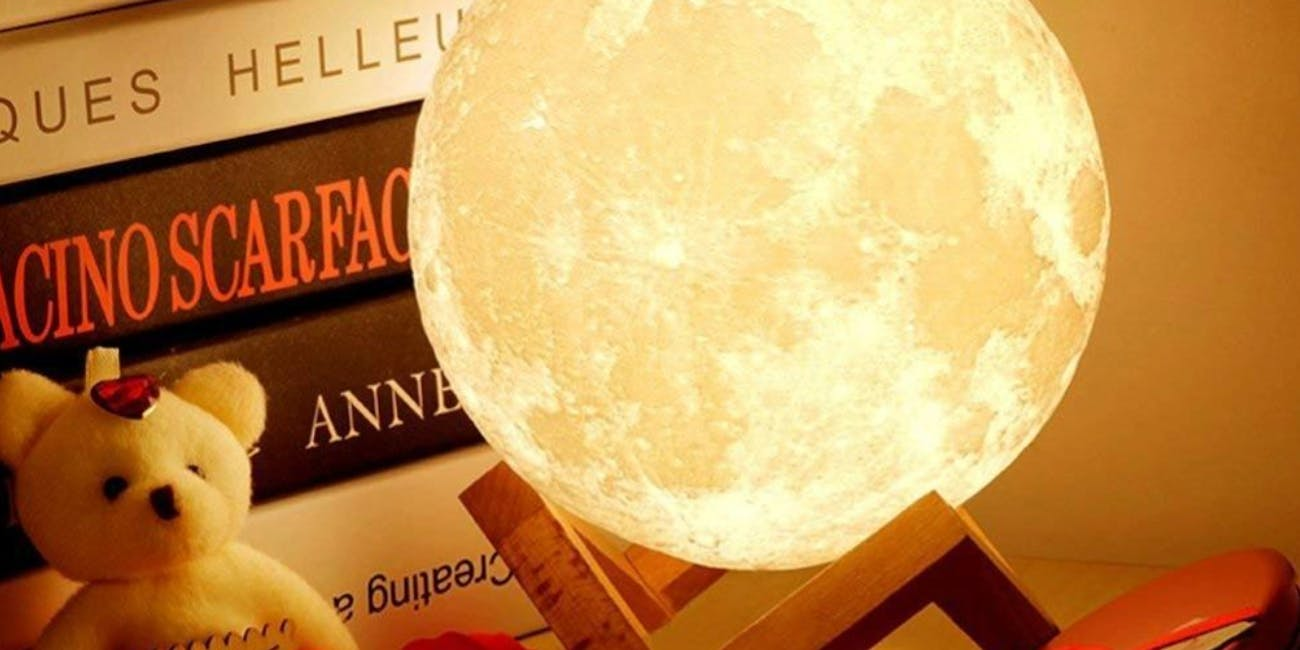 This Glowing Moon Lamp Changes to 16 Different Colors