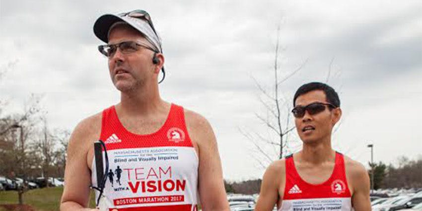 Erich Manser (left) ran this year's Boston Marathon with the assistance of wearable tech instead of his regular guide, David (right).