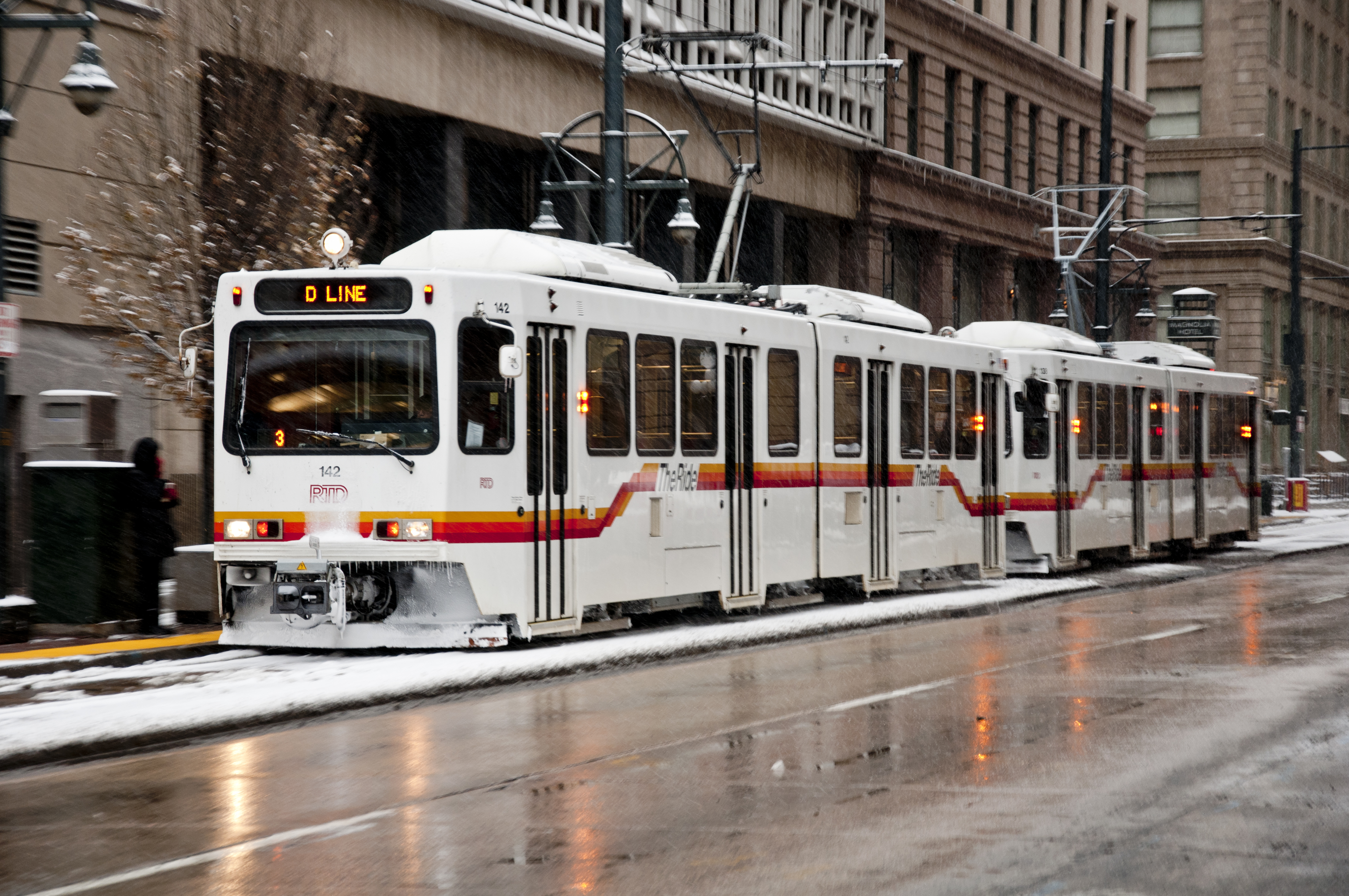 Denver RTD light-rail train, on the D-Line, moving southwest on Stout Street between 16th and 17th Streets, in downtown Denver.