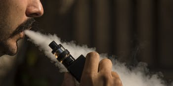 Close up shot from a man while vaping