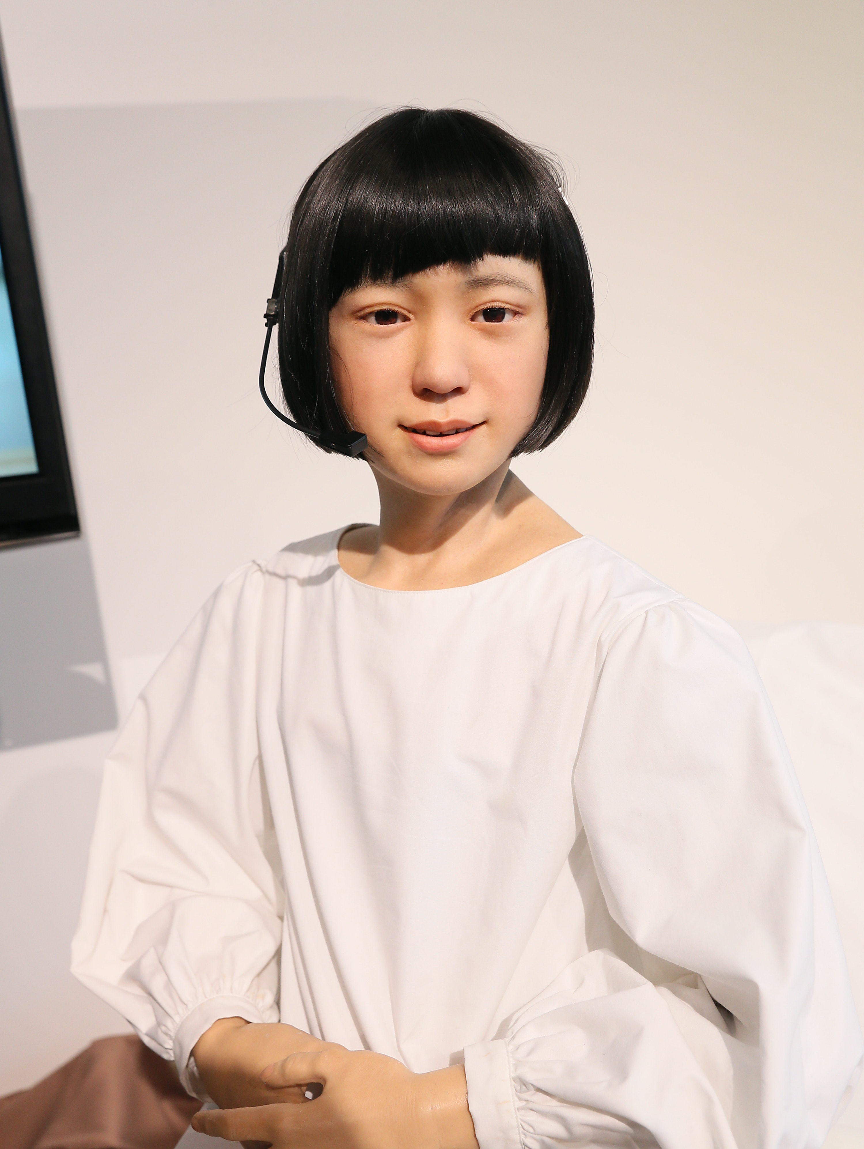 TOKYO, JAPAN - JANUARY 20:  Humanoid robot 'Kodomoroid' talks during the press conference to introduce the sociable robots, 'CommU' and 'Sota' hosted by only the robot science communicator Otonaroid and the robot anchor Kodomoroid at the National Museum of Emerging Science and Technology (Miraikan) on January 20, 2015 in Tokyo, Japan. CommU and Sota, developed to improve humanoids' sense of interaction in dialogue, make people feel more engaged in conversation with them by featuring diverse eye movements and gaze directions.  (Photo by Ken Ishii/Getty Images)