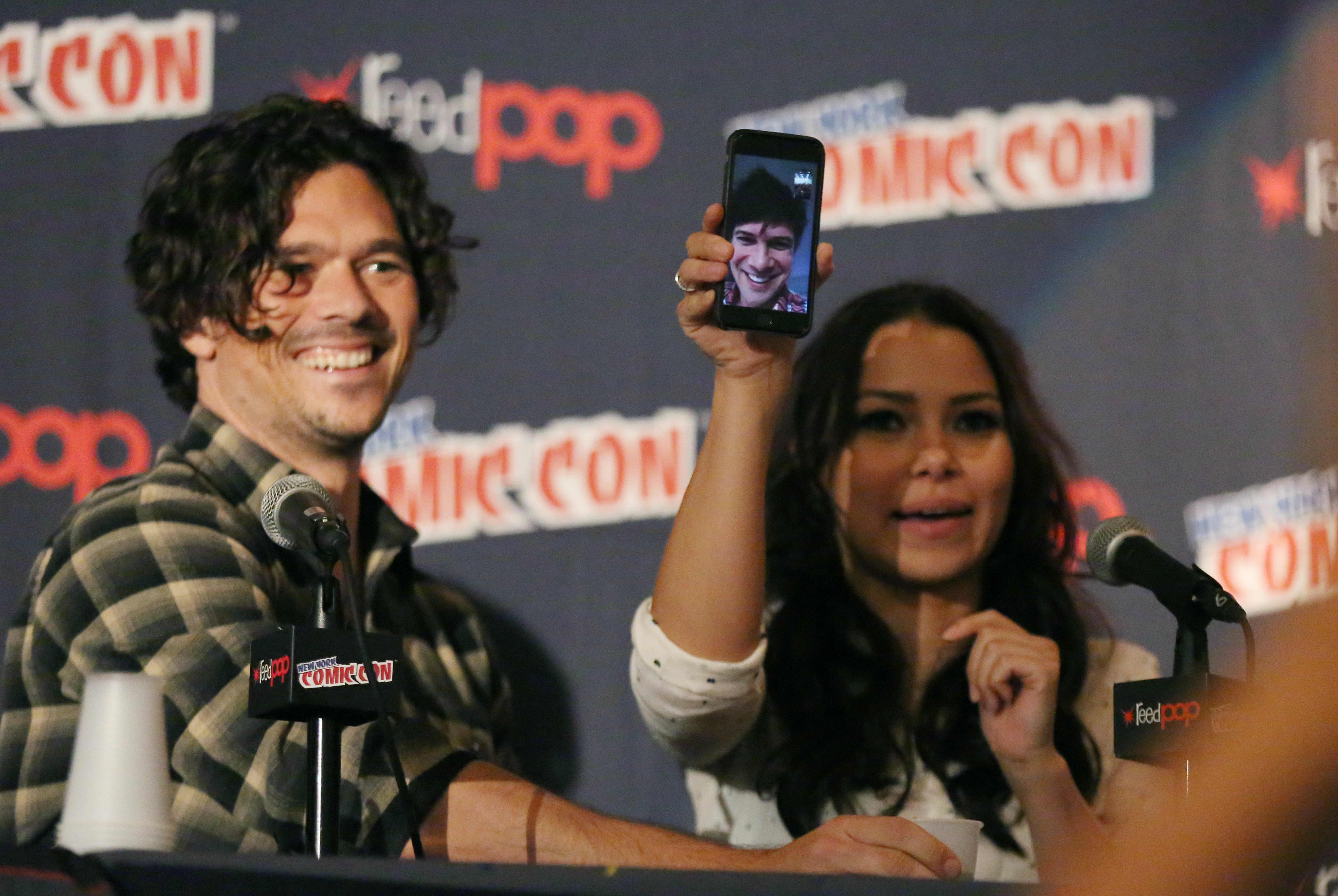 Luke Arnold, Toby Schmitz via phone, and Jessica Parker Kennedy at the New York Comic Con 'Black Sails' panel