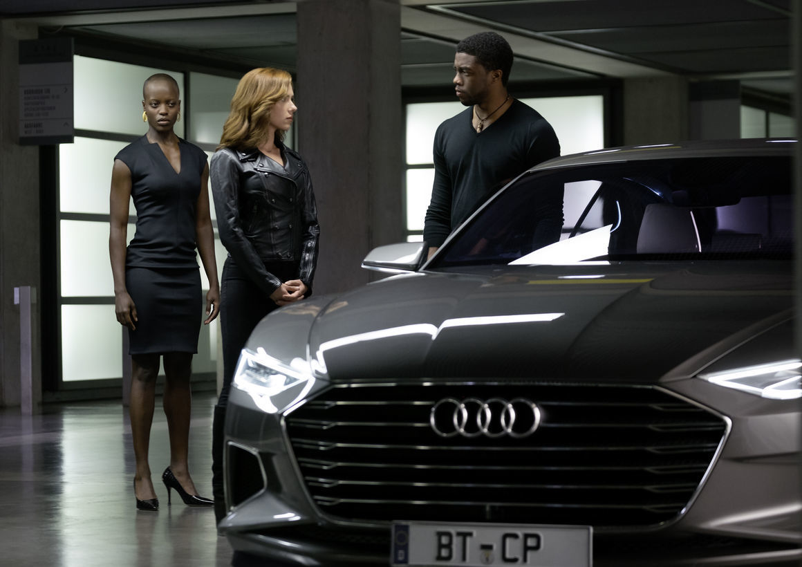 Florence Kasumba as Ayo, Scarlett Johansson as Black Widow, and Chadwick Boseman as T'Challa