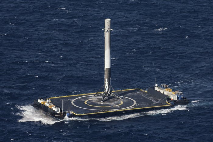"""The Falcon 9 stands up on the droneship """"Of Course I Still Love You', the name of which was taken from a ship in an Iain M. Banks book."""