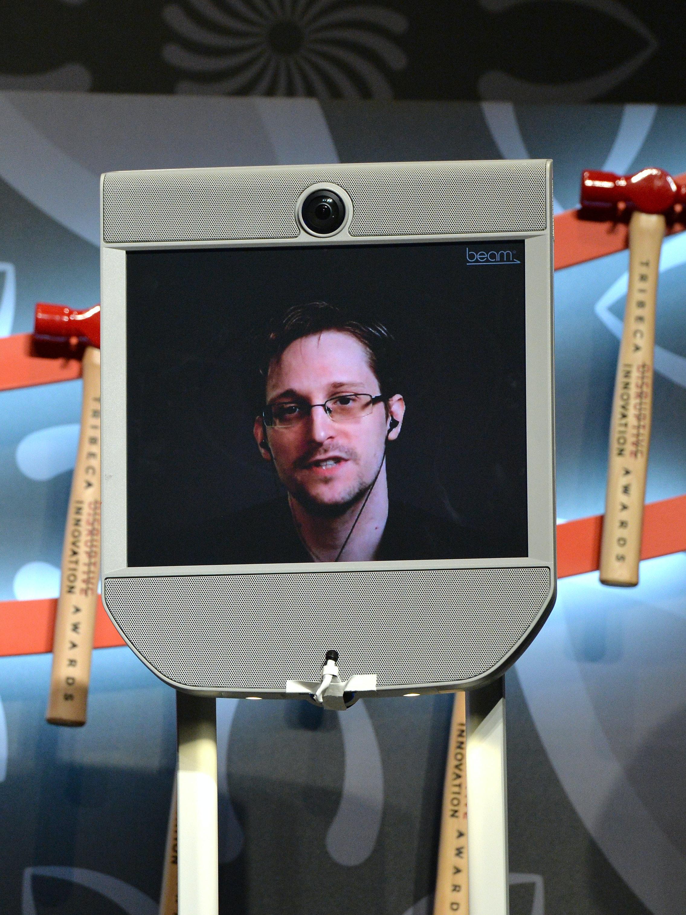 NEW YORK, NY - APRIL 22:  Edward Snowden (via monitor) speaks on stage at Tribeca Disruptive Innovation Awards - 2016 Tribeca Film Festival at BMCC John Zuccotti Theater on April 22, 2016 in New York City.  (Photo by Slaven Vlasic/Getty Images for Tribeca Film Festival)