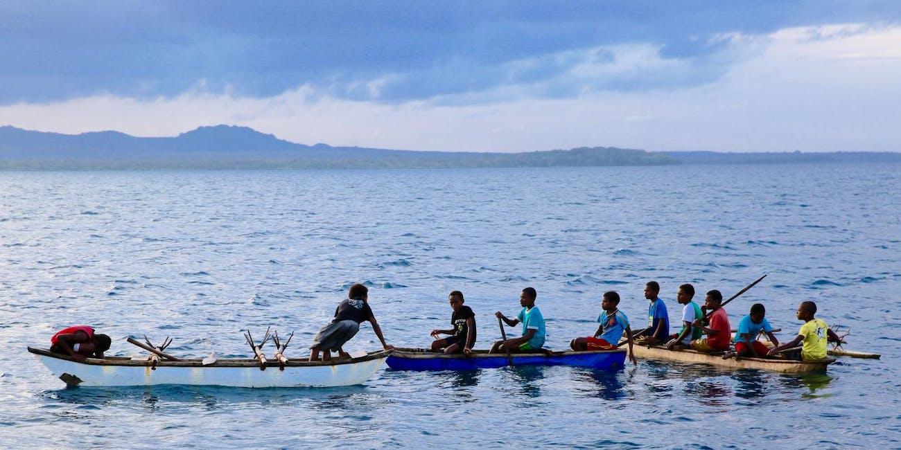 Young men in canoes in Northwest Malakula, Vanuatu.