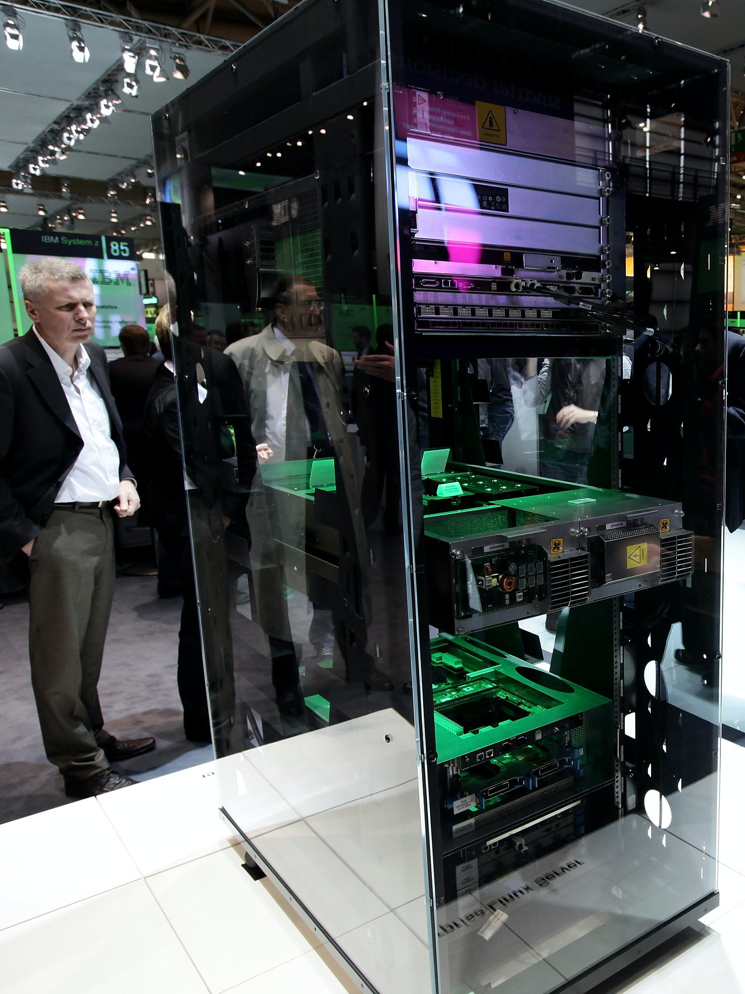 Visitors look at an Enterprise Linux Server at the IBM stand at the CeBIT Technology Fair on March 3, 2010 in Hannover, Germany.