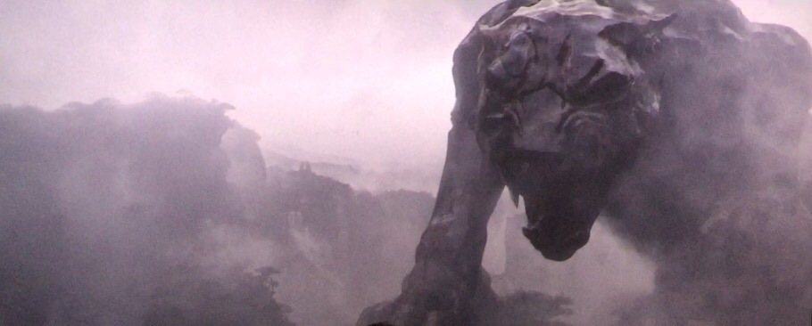 A panther statue looms in the mist in Wakanda.