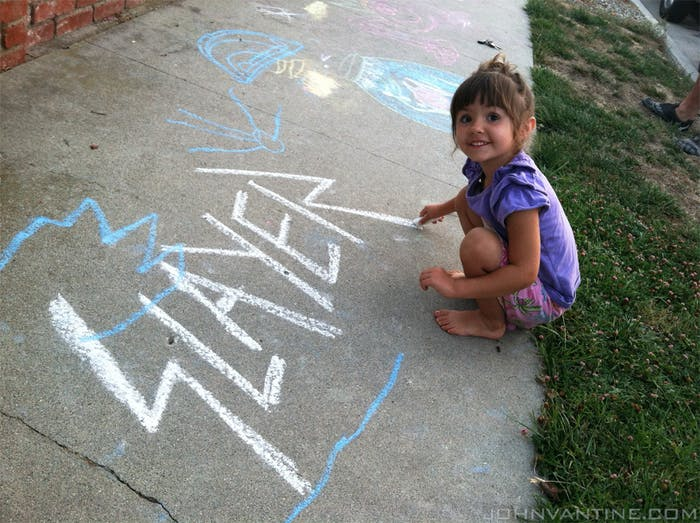 A little girl helps finish off the 'R' in the Slayer logo.