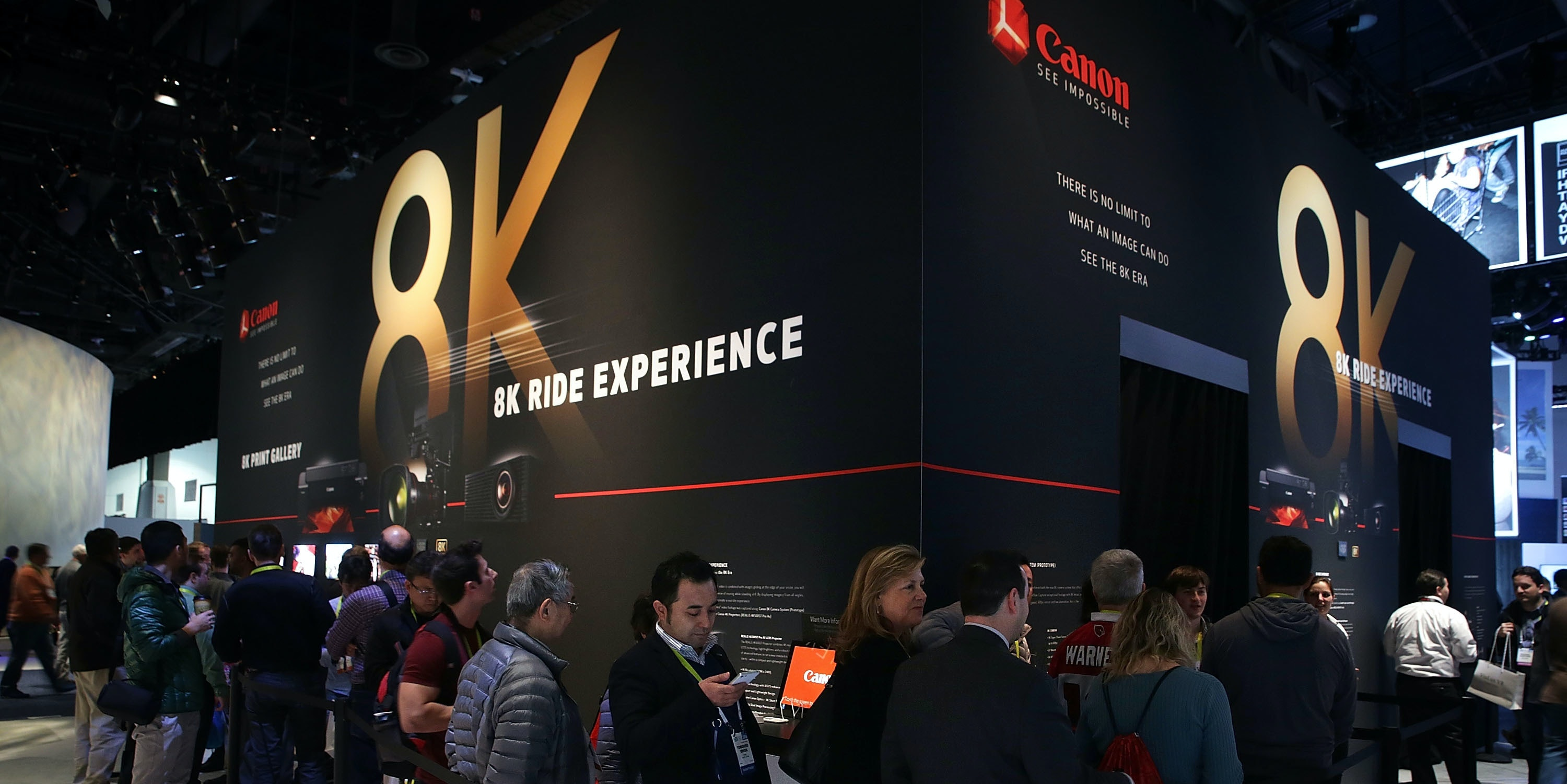 LAS VEGAS, NV - JANUARY 07:  Show attendees wait in-line for the Canon 8K Ride Experience at CES 2016 at the Las Vegas Convention Center on January 7, 2016 in Las Vegas, Nevada. CES, the world's largest annual consumer technology trade show, runs through January 9 and features 3,600 exhibitors showing off their latest products and services to more than 150,000 attendees.  (Photo by Alex Wong/Getty Images)
