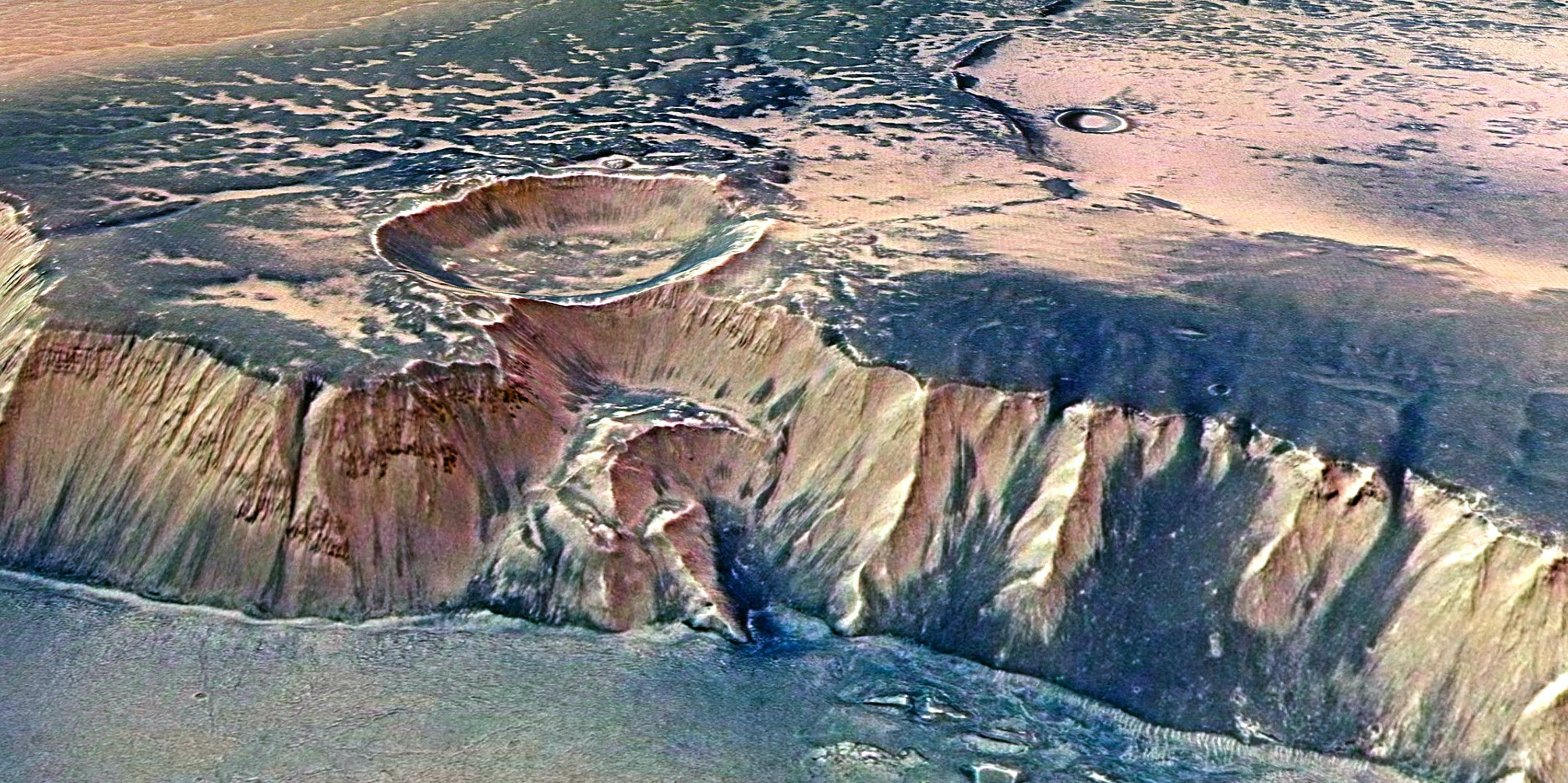 The Echus Chasma, one of the largest water source regions on Mars, is pictured from ESA's Mars Express.