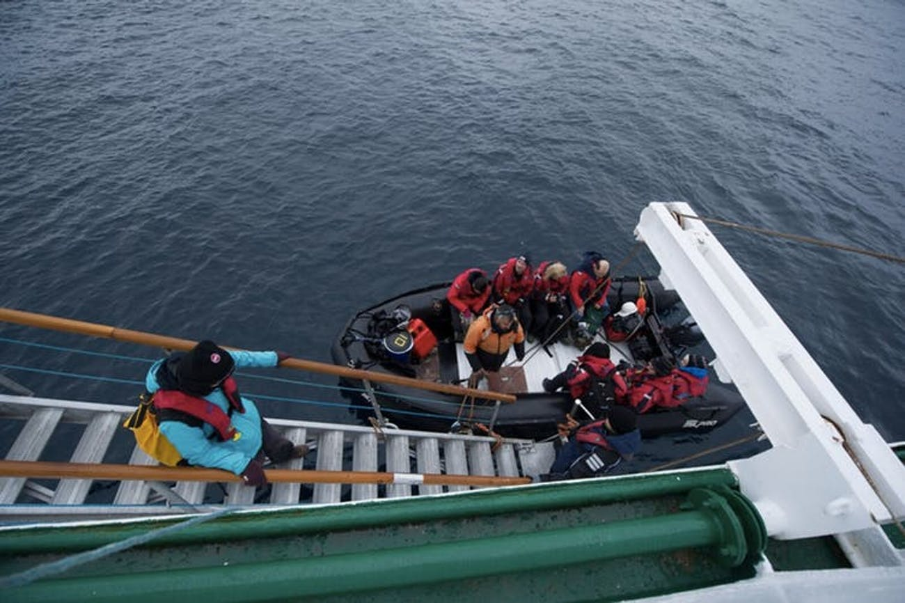 Passengers disembark the Akademik Ioffe after the Russian ship ran aground in the Canadian Arctic.
