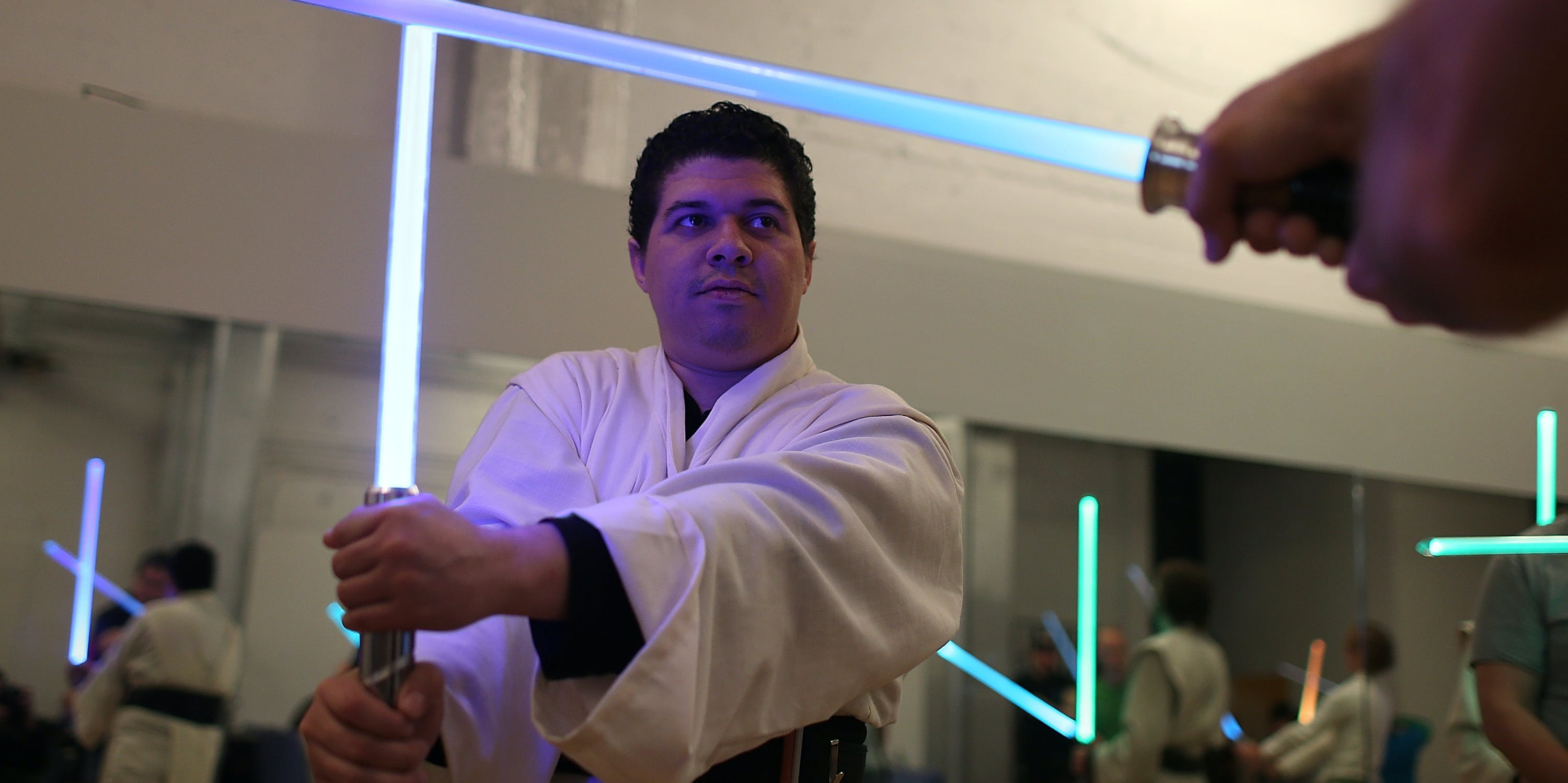 SAN FRANCISCO, CA - FEBRUARY 24:  Julio Reyes practices combat moves with a lightsaber during a Golden Gate Knights class in saber choreography on February 24, 2013 in San Francisco