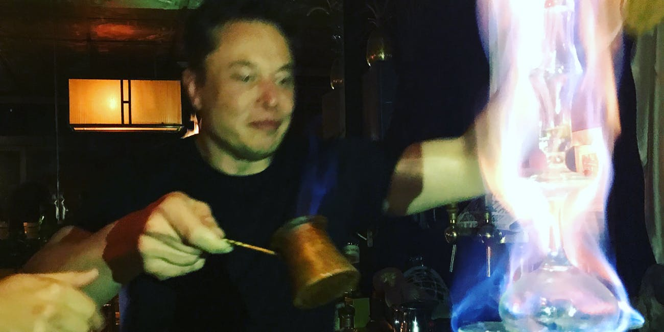 Elon Musk pouring absinthe