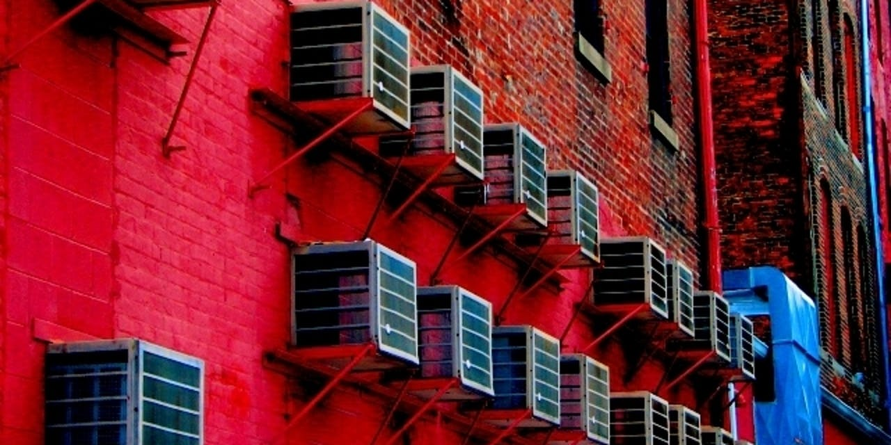 Air conditioners red brick bulding