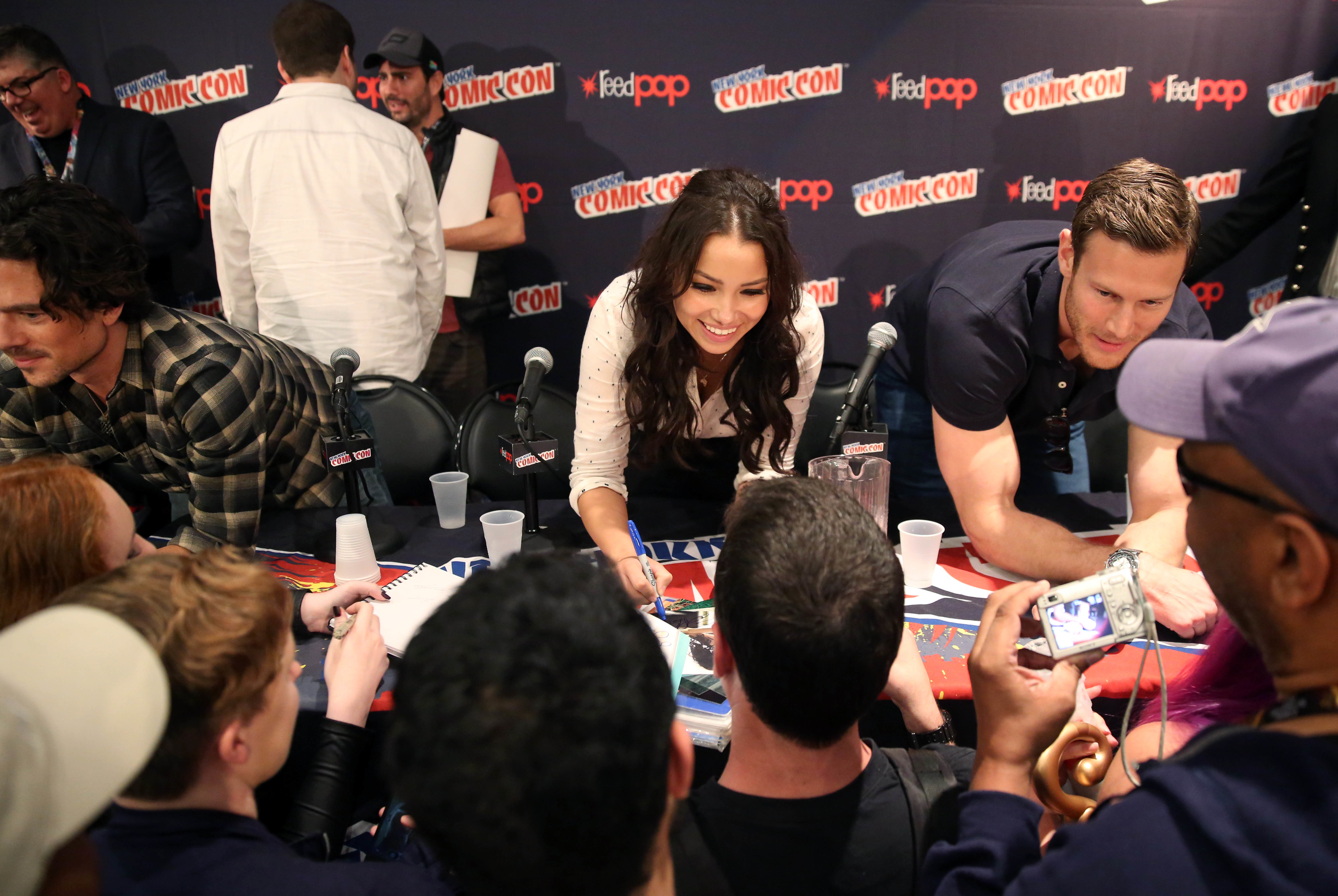 Luke Arnold, Jessica Parker Kennedy, and Tom Hopper sign autographs for fans