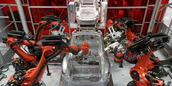 Kuka robots work on Tesla Model S cars in the Tesla factory in Fremont, California.