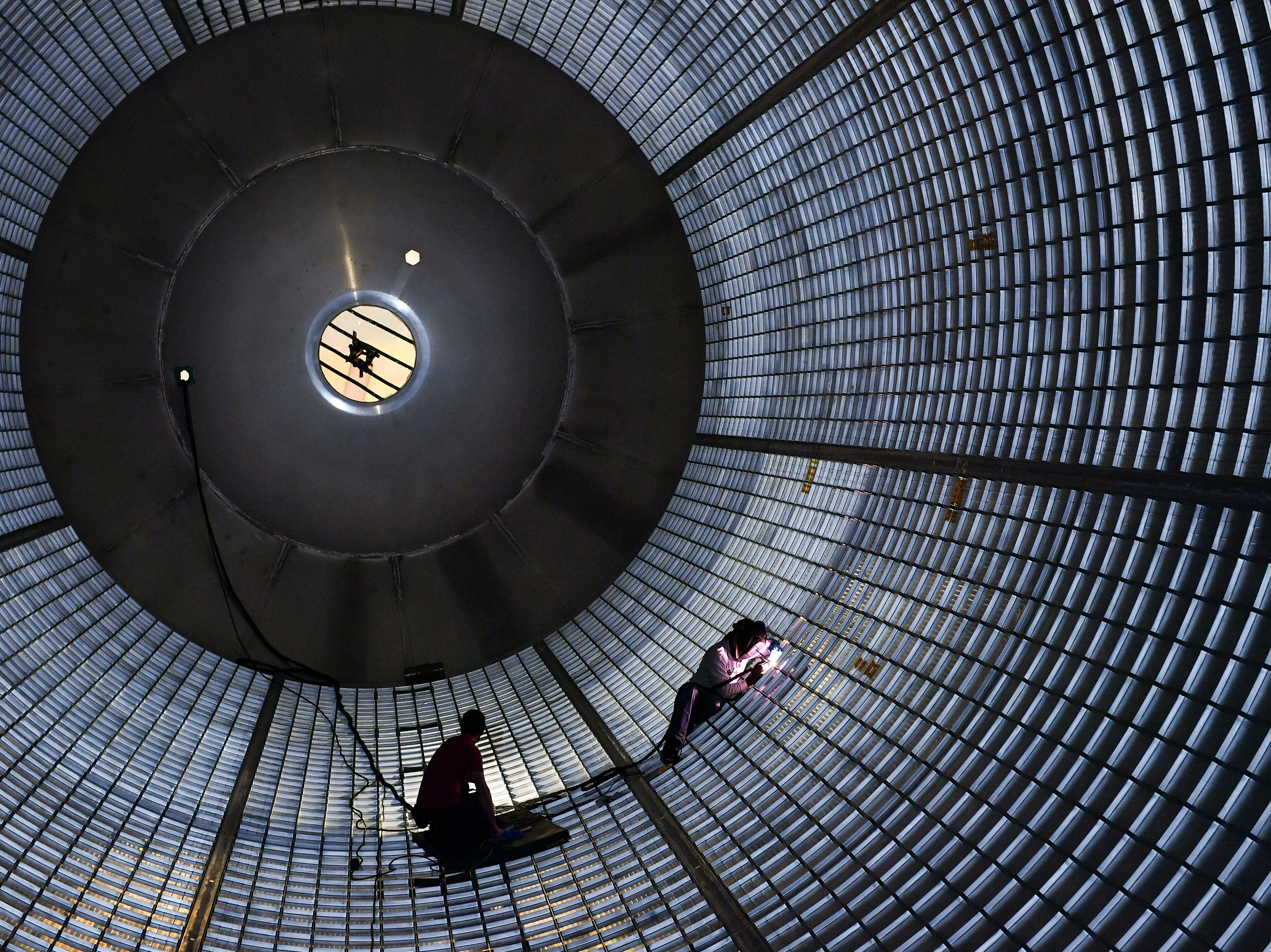 Welders inside a large liquid hydrogen tank