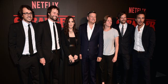 LOS ANGELES, CA - JULY 11:  Executive producer Dan Cohen, creator/executive producer Ross Duffer, actress Winona Ryder, Chief Content Officer for Netflix, Ted Sarandos, VP of Original Content for Netflix Cindy Holland, creator/executive producer Matt Duffer and executive producer Shawn Levy attend the Premiere of Netflix's 'Stranger Things' at Mack Sennett Studios on July 11, 2016 in Los Angeles, California.  (Photo by Alberto E. Rodriguez/Getty Images)