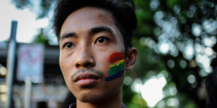 MANILA, PHILIPPINES - JUNE 14: An LGBT student activist has his face painted in rainbow colors in solidarity with the victims of the mass shooting at the Pulse nightclub in Orlando, Florida on June 14, 2016 in Manila, Philippines. 49 people were killed after a gunman opened fire at nightclub frequented by gays lesbians and transgender people in the deadliest mass shooting in US history. (Photo by Dondi Tawatao/Getty Images)