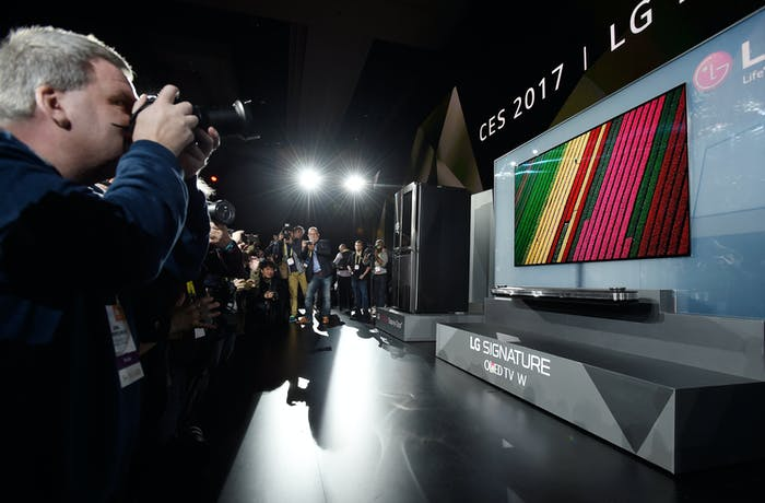 Members of the media photograph the LG Signature OLED TV W during a LG press event on Wednesday in Vegas.