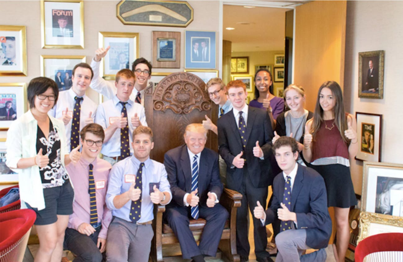 The Lampoon staff, posing as student journalists from the Crimson, with now-President Donald Trump.