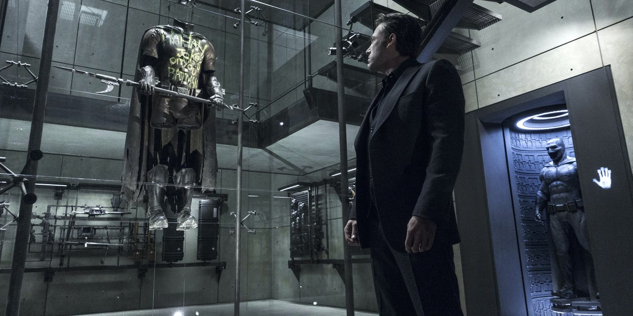 The DCEU Batcave is all glass, stone, and rigid angles meant to reflect Batman's brutality.