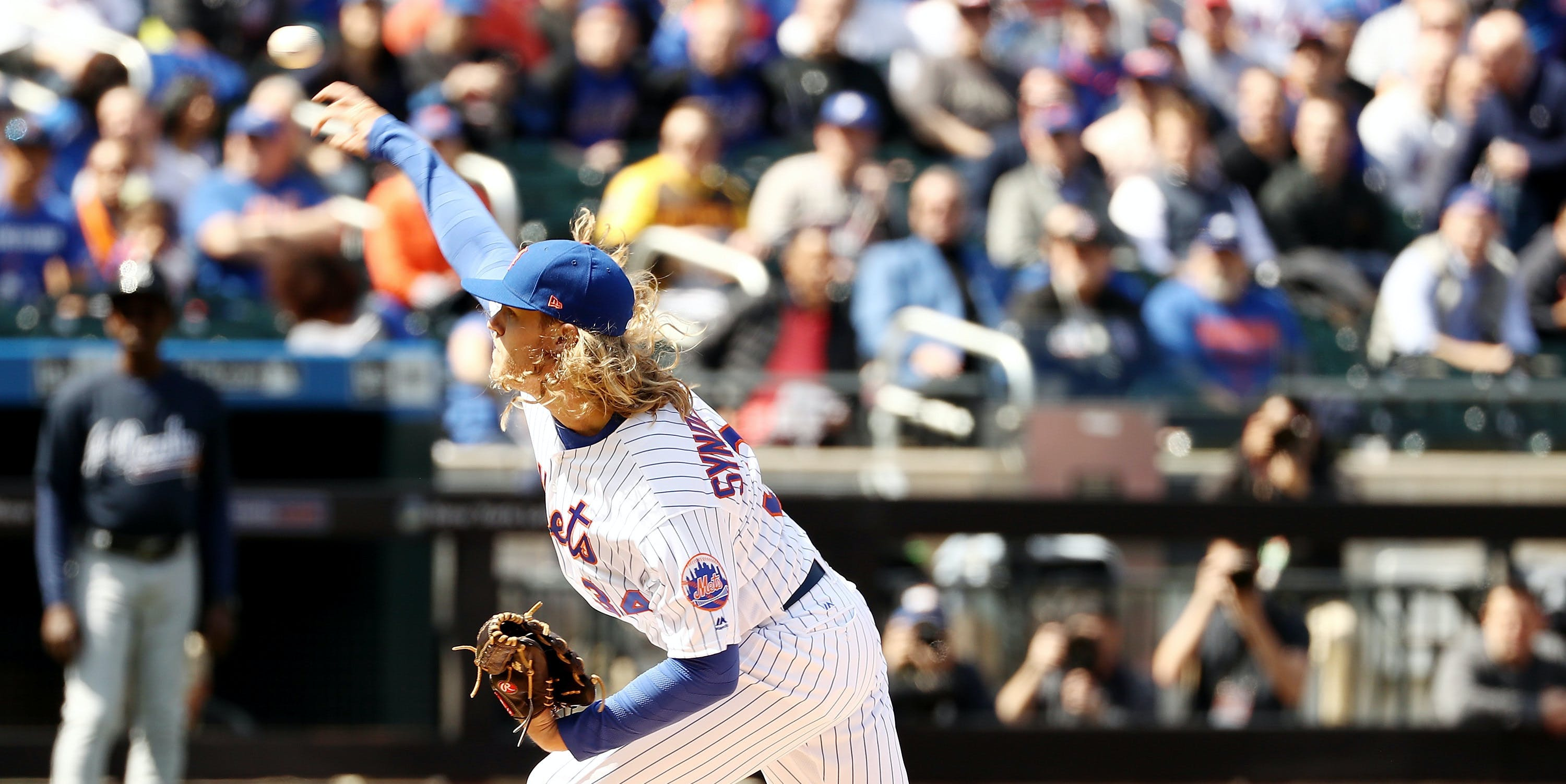NEW YORK, NY - APRIL 03:  Noah Syndergaard #34 of the New York Mets delivers a pitch in the first inning against the Atlanta Braves during Opening Day on April 3, 2017 at Citi Field in the Flushing neighborhood of the Queens borough of New York City.  (Photo by Elsa/Getty Images)