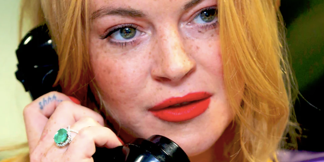 LONDON, ENGLAND - SEPTEMBER 12:  Lindsay Lohan making a trade at BGC Annual Global Charity Day at Canary Wharf on September 12, 2016 in London, England.  (Photo by Tim P. Whitby/Getty Images)