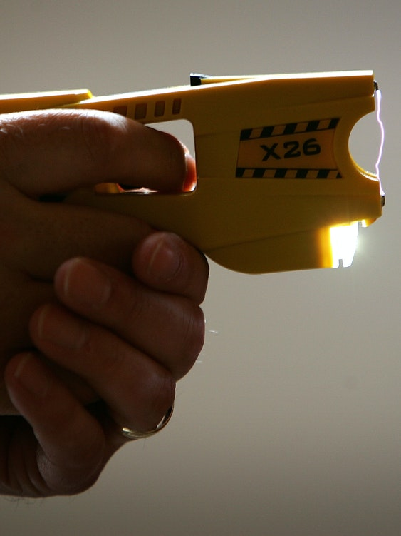 BLACKPOOL, UNITED KINGDOM - MAY 16:  A representative from Taser International fires the companies latest X26 stun gun during the Police Federation Conference at Winter Gardens on May 16, 2007 in Blackpool, England. British Home Secretary John Reid announced today that more Taser guns could be deployed on the streets of the UK by frontline police officers. The Taser's which stun a person with up to 50,000 volts, and can currently only be carried by armed response officers have some under harsh criticism from Amnesty International  who claim more than 70 deaths in Canada and America have been linked to the weapon.  (Photo by Christopher Furlong/Getty Images)