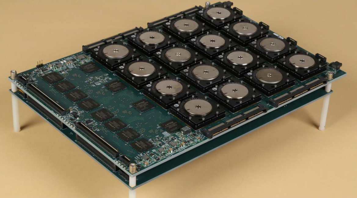 A circuit board with 16 of the new brain-inspired chips in a 4×4 array along with interface hardware. The board is being used to rapidly analyze high-resolution images. DARPA-funded researchers have developed one of the world's largest and most complex computer chips ever produced—one whose architecture is inspired by the neuronal structure of the brain and requires only a fraction of the electrical power of conventional chips.