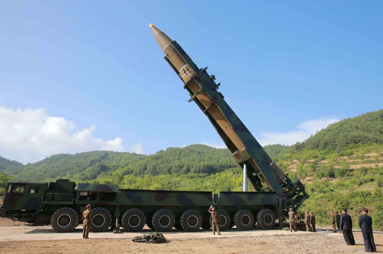 The Hwasong-14 on a transporter-erector vehicle.