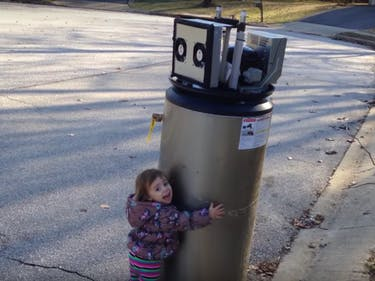 This Adorable Child Has Not Yet Learned to Fear the Machines